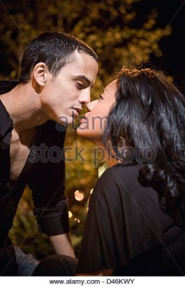 a-hispaniclatino-couple-about-to-kiss-on-a-date-d46kwy